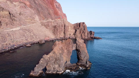 Aerial view of a scenic natural arch in El Hierro island, Canary islands, Spain Live Action