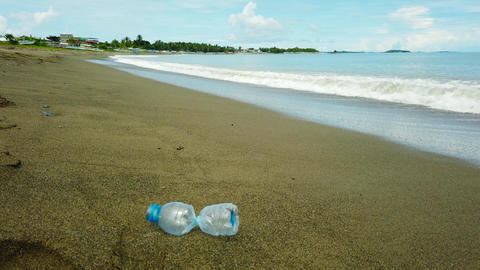 A beach is polluted with plastic and waste Live Action