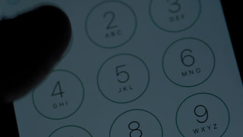 Dialing 911 emergency call on cell phone screen nightime Footage