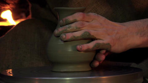 Creation of a clay pot. A man's hands sculpting a traditional clay pot Live Action
