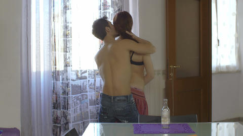 sex in front of the window: couple kissing Footage