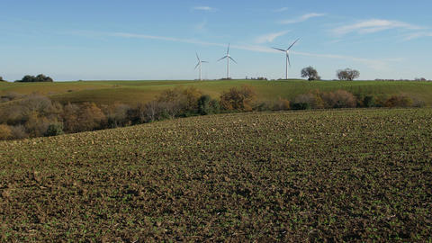 countryside with wind turbines in background Footage