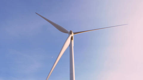blue sky and wind turbine, concept of green energy and earth safe Footage