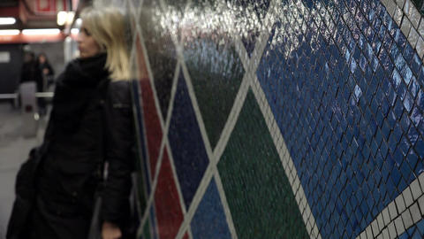 sad woman out of focus waiting for someone in a underground station Footage