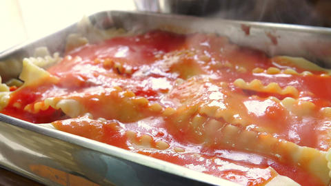 preparing typical italian lasagna with pasta, meat, and cheese Footage