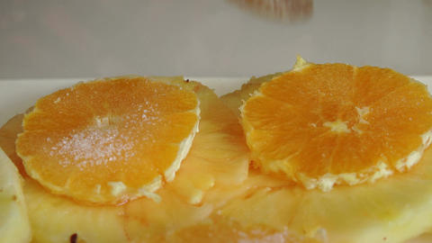 cooking some cake with slices of orange and sugar Footage