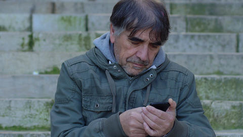 thoughtful man using smart phone: mobile touch screen phone Footage