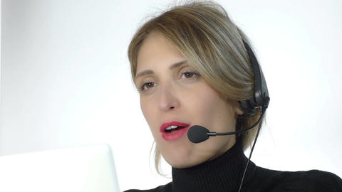 beautiful secretary is working with headphone microphone and computer Footage