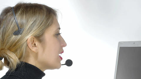 call center operator: woman working with headset and computer Footage