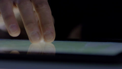 finger of young woman using touchscreen of tablet computer Footage