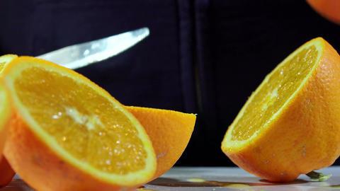 making orange juice, cutting oranges Footage