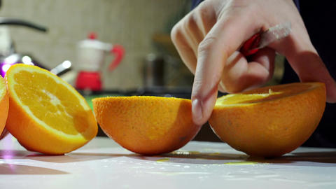 cutting fresh oranges to squeezing oranges and make orange juice Footage