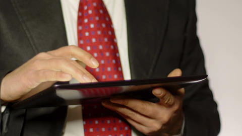 businessman using tablet computer on his legs Live Action