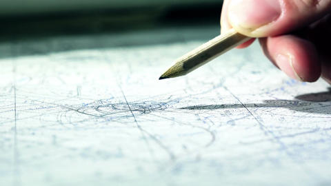 making marks over a map with a pencil Footage