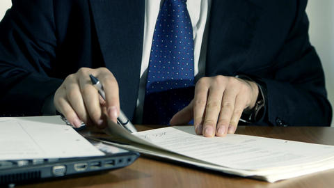 businessman at work signs documents on wooden desk Footage
