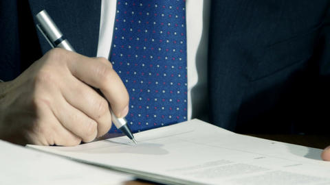 businessman signs documents or agreement in his office Footage