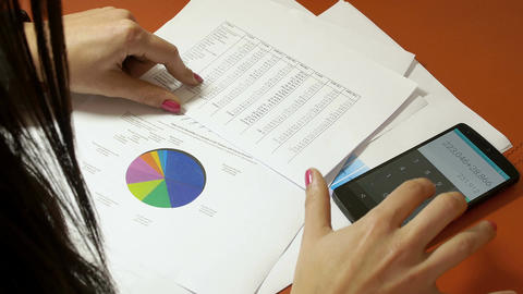 businesswoman Working with calculator and financial charts Footage