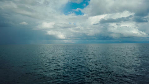 Tropical blue sea and blue sky with clouds Live Action