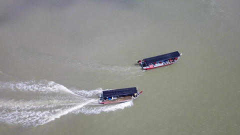 A fishing boats pass another boats with faster speed cruising speed Live Action