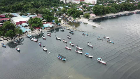 Aerial view fishing boats park in a row with rope Live Action