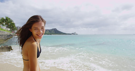 Carefree Young Woman Playing With Windswept Hair At Waikiki Beach Live Action