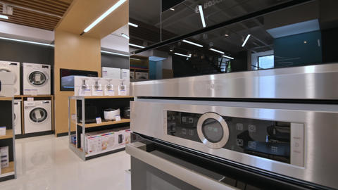 Kitchen equipment in domestic appliance store Live Action