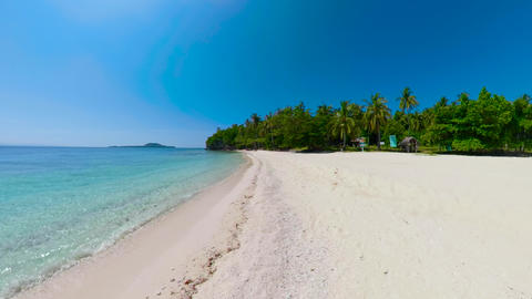 Tropical island with a beach and palm trees. Mahaba Island, Philippines Live Action