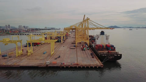 Aerial view KMTC line container ship at container terminal Live Action