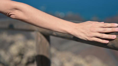 close up light skin female hand touch and sliding over wooden bridge hand Live Action