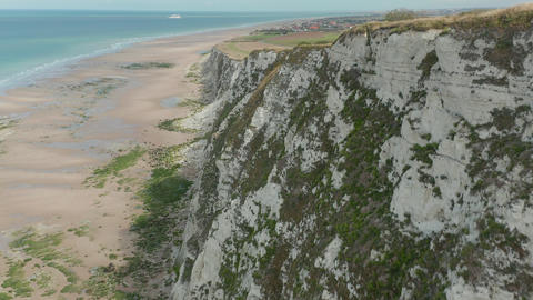 Epic White Cliff from Aerial Birds View Perspective with Green and Brow Pasture Live Action