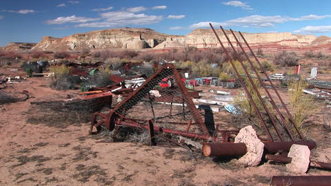 Long-shot of a trash dump in a desert Stock Video Footage