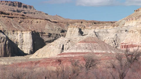 Zoom back from a Southwest desert scenic shot to a junkpile Stock Video Footage
