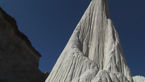 Pan-up a white limestone rock formation in a desert Stock Video Footage