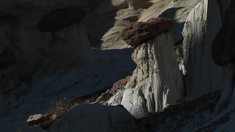 Medium-shot of rock formations in a desert canyon Stock Video Footage