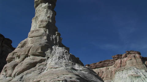 Pan-up a limestone rock formation in a desert canyon Footage
