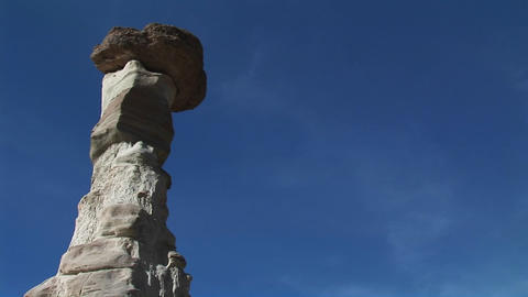 Medium-shot of a boulder balanced atop a limestone pillar Stock Video Footage
