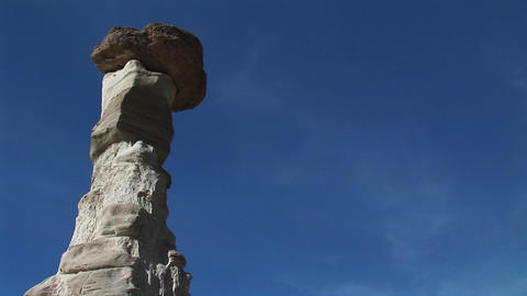 Medium-shot of a boulder balanced atop a limestone pillar Footage