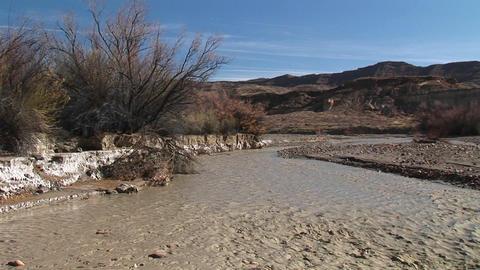 Medium-shot of a stream flowing through Death Valley,... Stock Video Footage