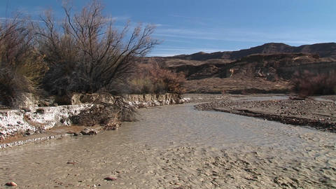 Medium-shot of a stream flowing through Death Valley,... Stock Video Footage