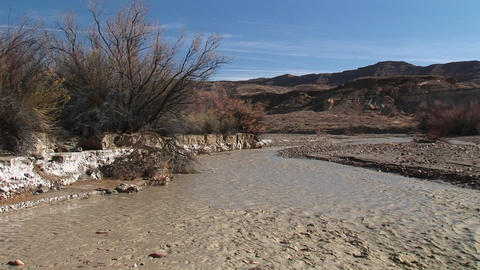 Medium-shot of a stream flowing through Death Valley, California Footage
