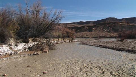 Medium-shot of a stream flowing through Death Valley, California Footage