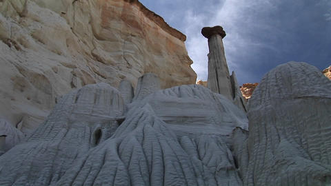 Pan-left of the eroded limestone rock formations standing... Stock Video Footage