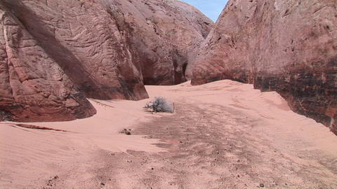 Medium-shot of the sandy floor of a granite canyon Stock Video Footage