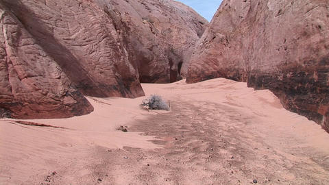 Medium-shot of the sandy floor of a granite canyon Footage