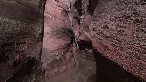 Pan-down the granite walls of a slot canyon Footage