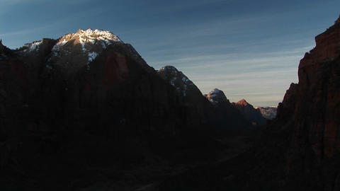 Long-shot of snow-covered mountain peaks Stock Video Footage
