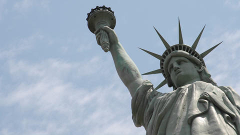 Time lapse of clouds behind the Statue Of Liberty in this... Stock Video Footage