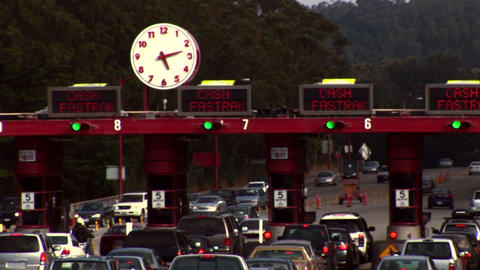 Time-lapse of traffic moving through a tollbooth Footage