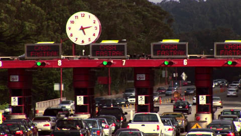 Time-lapse of traffic moving through a tollbooth Stock Video Footage