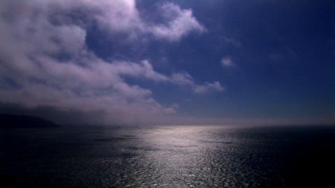 Time-lapse of clouds moving over the ocean Stock Video Footage